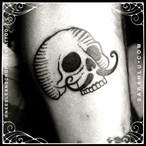 Sarah Lu Moustache Skull